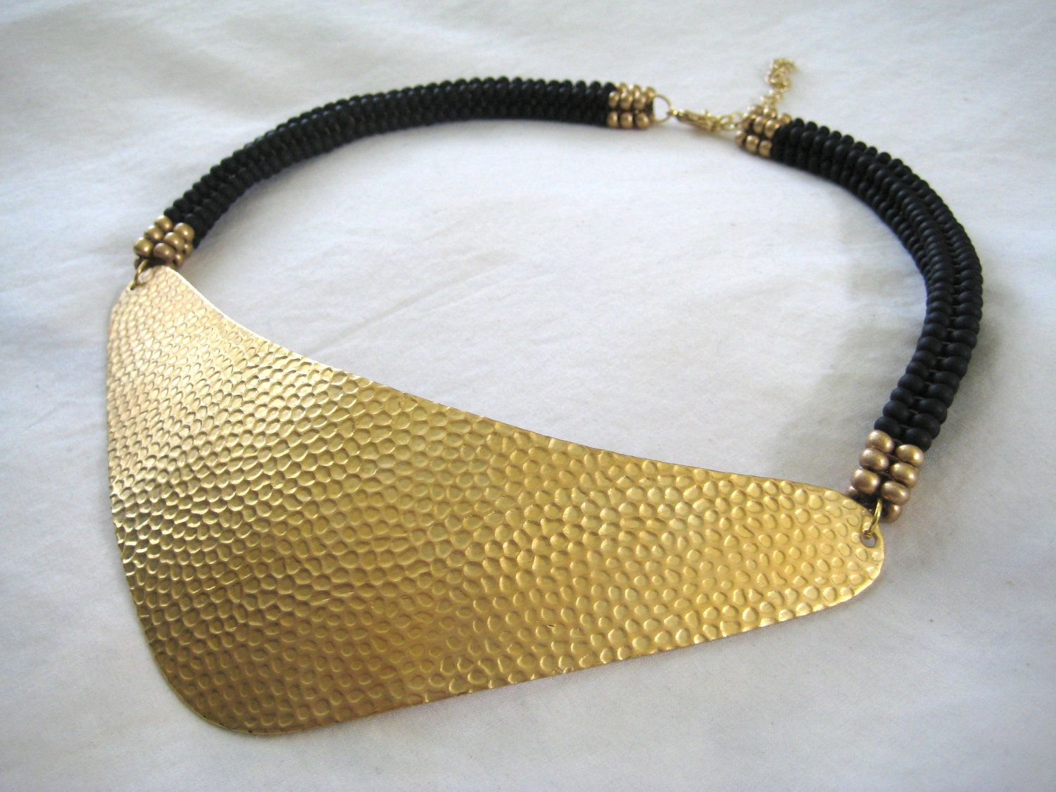 Hammered Gold Triangle Bib and Woven Beadwork Collar Necklace - Black/Gold. $92.00, via Etsy.