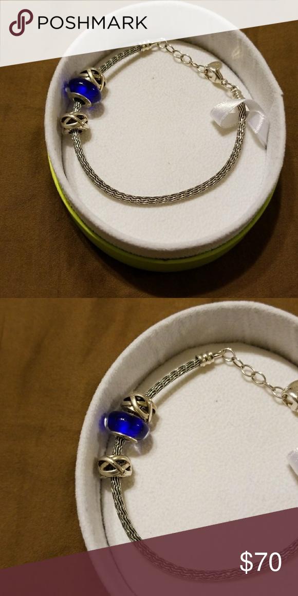 Chamilia Sliver Bracelet Blue charm attached to bracelet. Chamilia Jewelry Bracelets