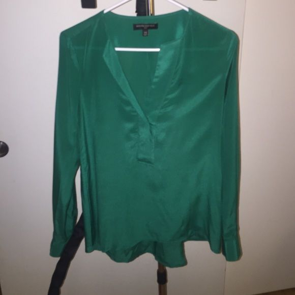 XS Green Silk V front Top by Banana Republic XS Green Silk V front Top by Banana Republic. Has 2 buttons on front so you can wear it with a top underneath or buttoned up for a more work-worthy look. Looks great tucked into a skirt! Banana Republic Tops Blouses