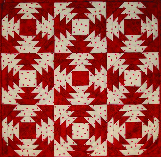 Red and white quilt from the NY Armory Quilt Show