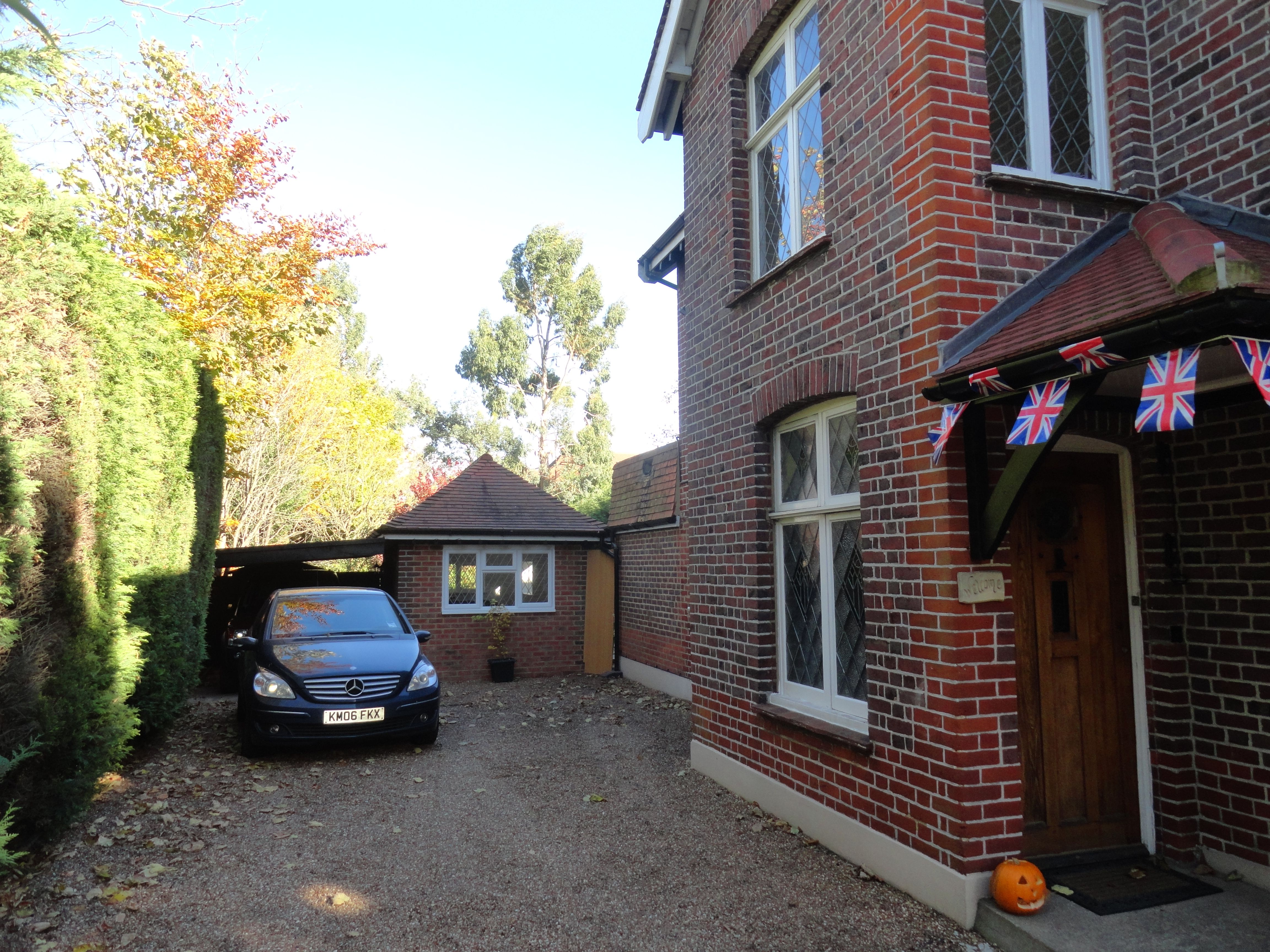 Garage conversion to create large living area in Epsom