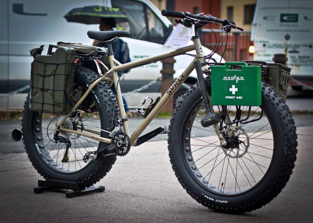 Post Zombie or Nuclear Apocalypse Bike. Surly Moonlander with 2x10 litre  jerry cans to scavange water fuel.Military shovel and mallet for  defence.1st aid ... 24eb5b2d4