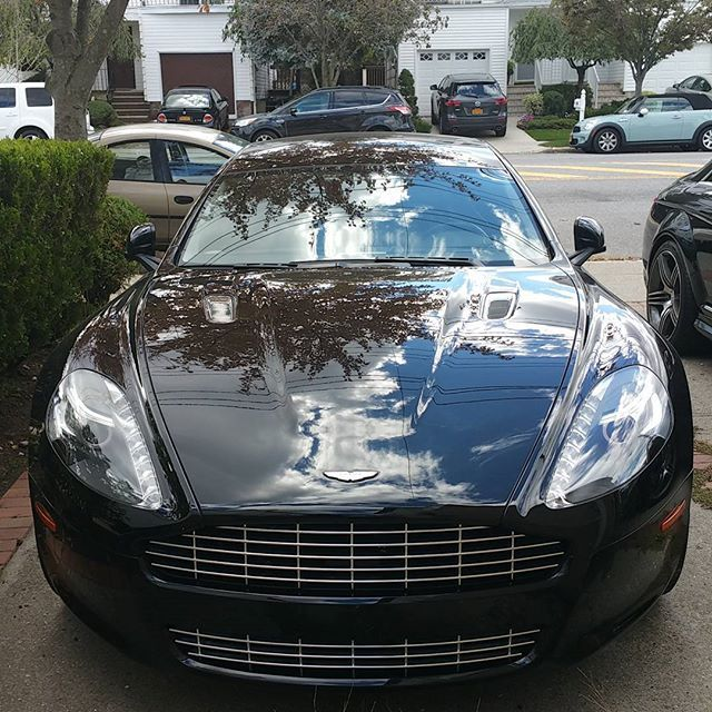 Black Aston Martin Rapide looking fast even in the driveway  Looks like a painting on the hood.  #rapide #astinmartin #leasecar #mslease #buycars