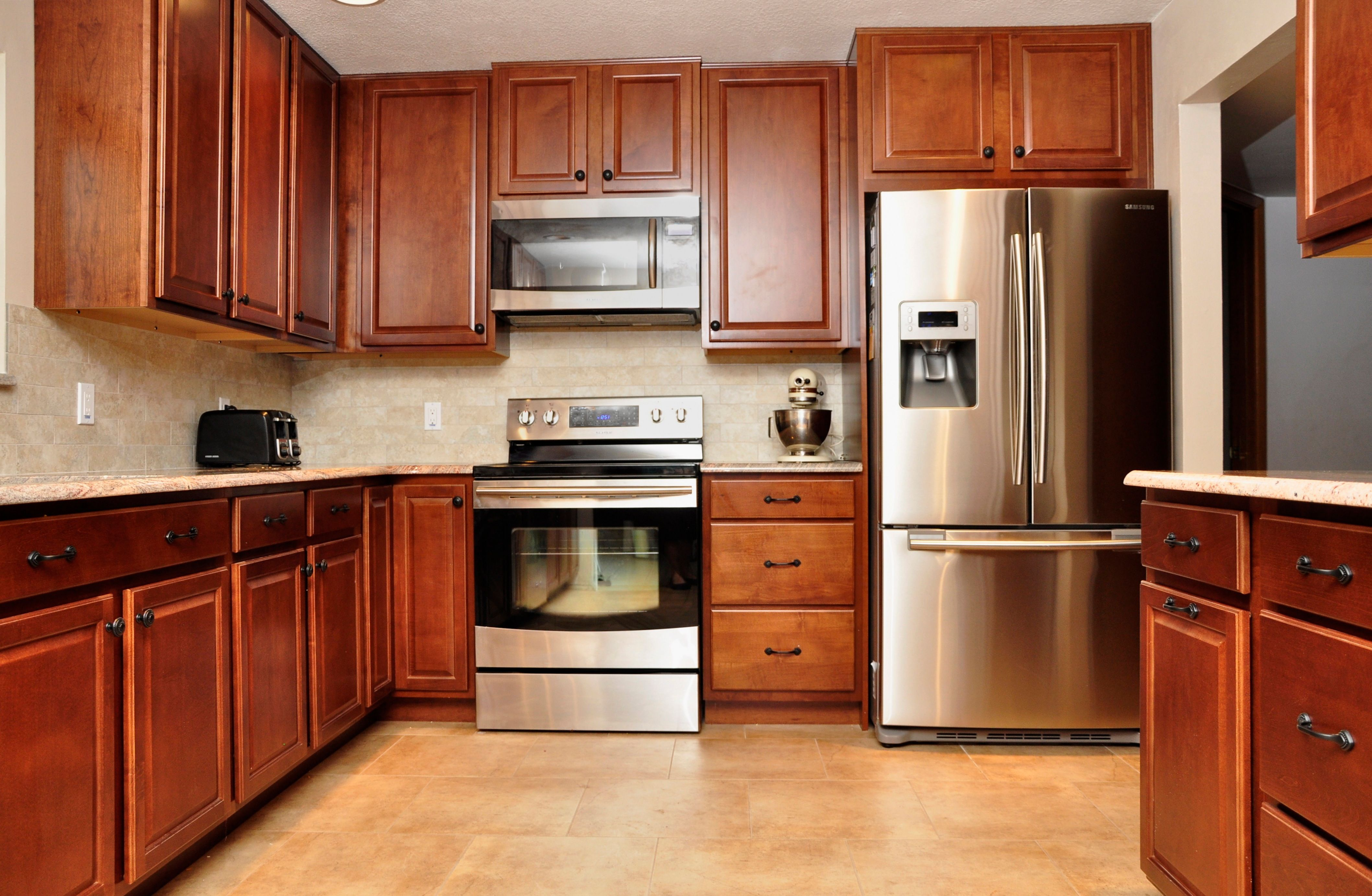 high gloss faux wood block counters dark cherry cabinets stainless steel appliances full on kitchen remodel appliances id=30670