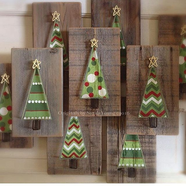 Aww, how sweet are these hand painted rustic Christmas trees?! Outlined with string and topped with a star ✨. Which one is your favorite?? I love the chevron ins best!. .  @originalsbysarahyoung  #christmastree #handpaintednailart #stringart #woodsign #woodsigns #farmhousedecor #buyhandmade #christmasdecor #rusticchristmas
