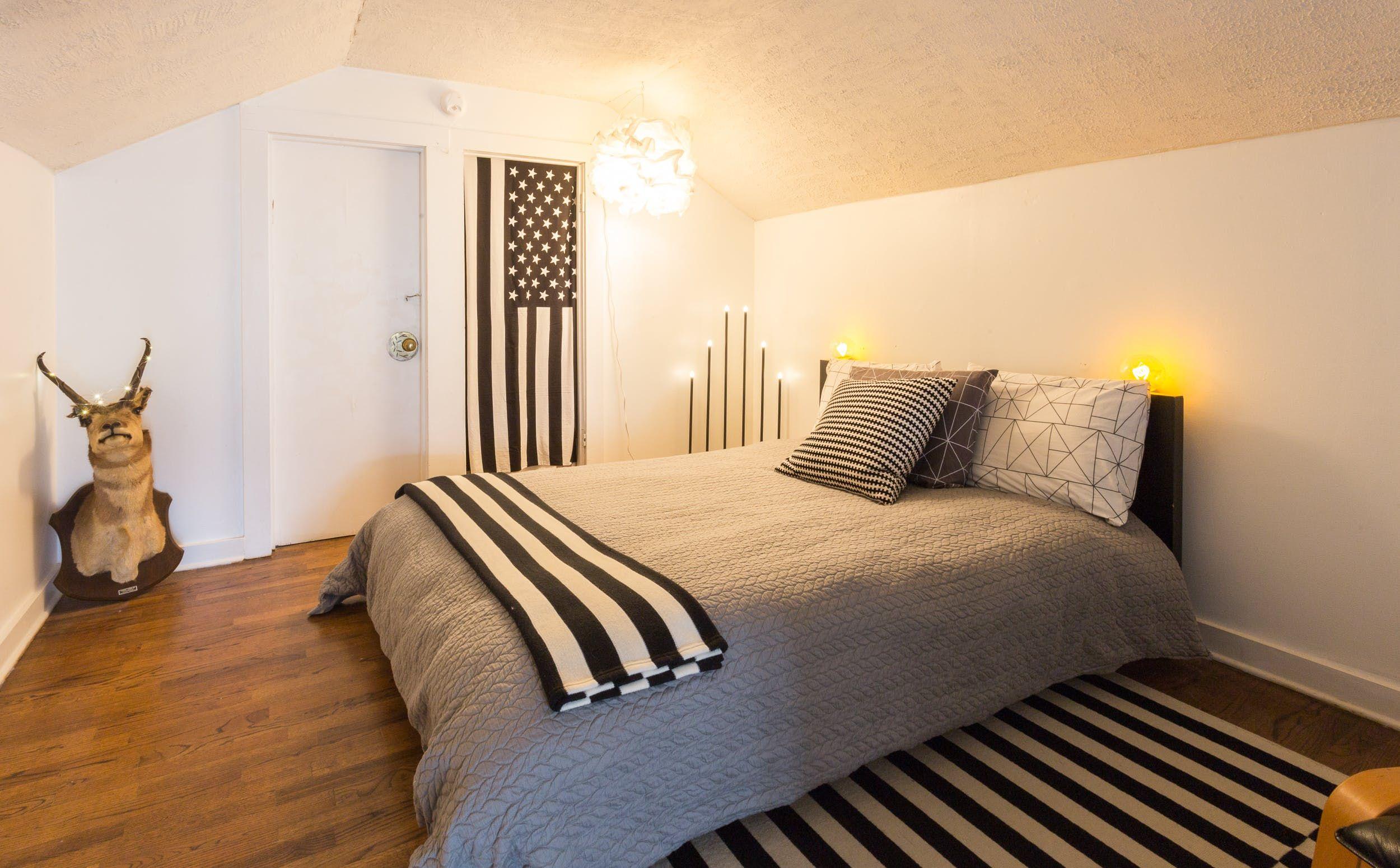 The guest bedroom with unique lighting fixtures