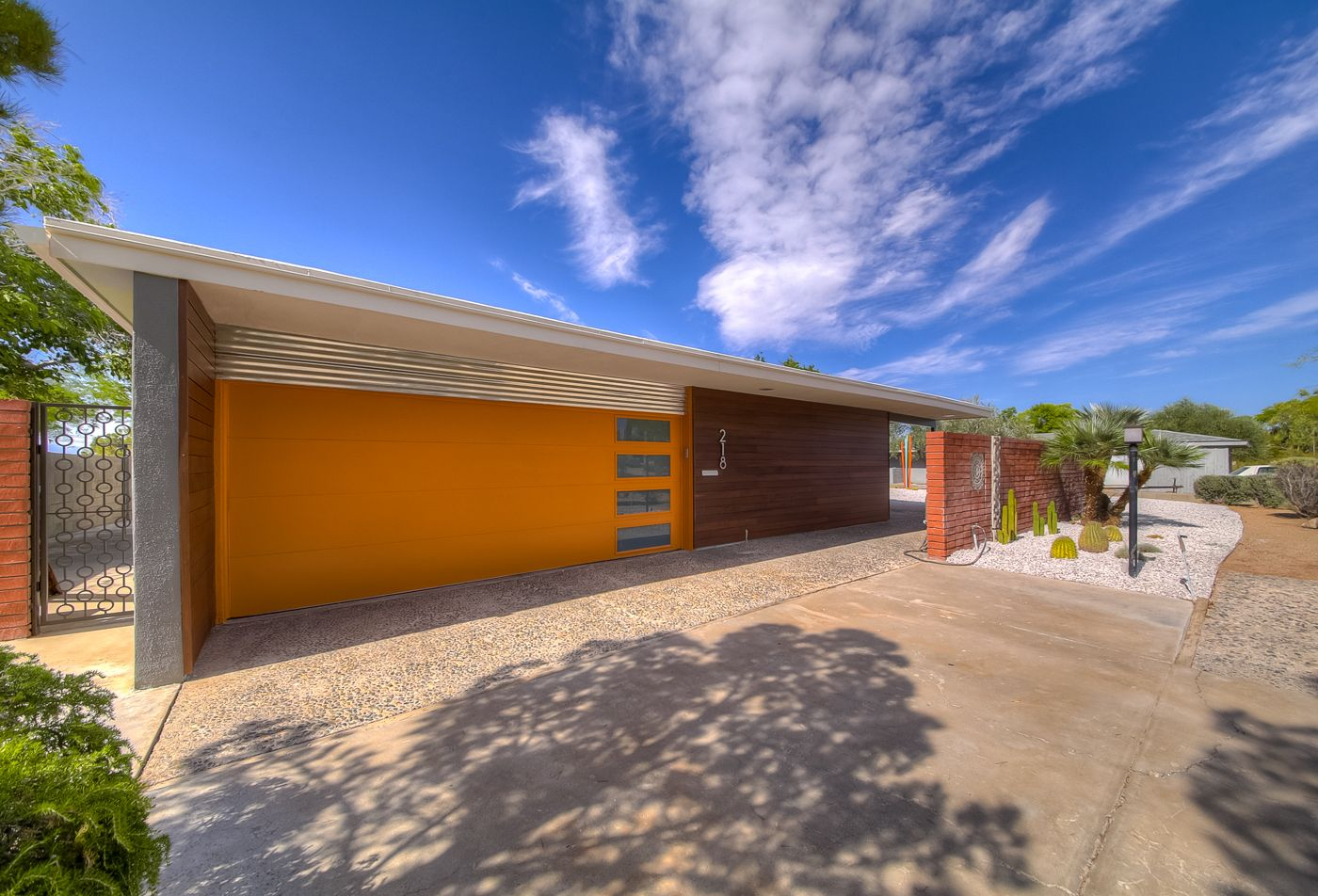 Clopay Modern Steel Collection Garage Door Painted Sw Amber Wave Adds Curb Appeal To This 1966 Mid C Garage Doors Garage Door Makeover Garage Door Installation
