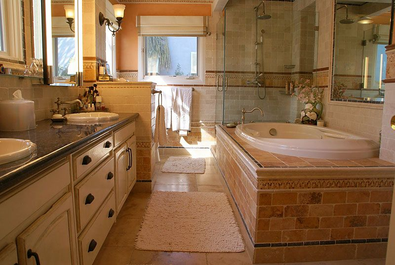 spanish interior design bathroom remodel with jacuzzi tub bidet and tumbled marble tilework - Bathroom Designs With Jacuzzi Tub