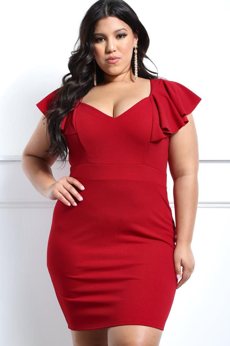 An evening ready plus size mini dress featuring a ruffled flounce