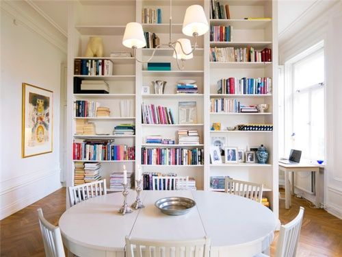 Break Up A Long Room With Bookshelf To Divide Living And Dining Areas