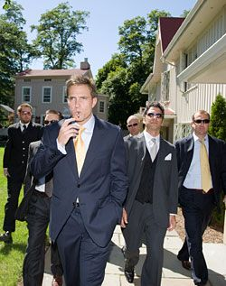 Navy blue suits with yellow ties
