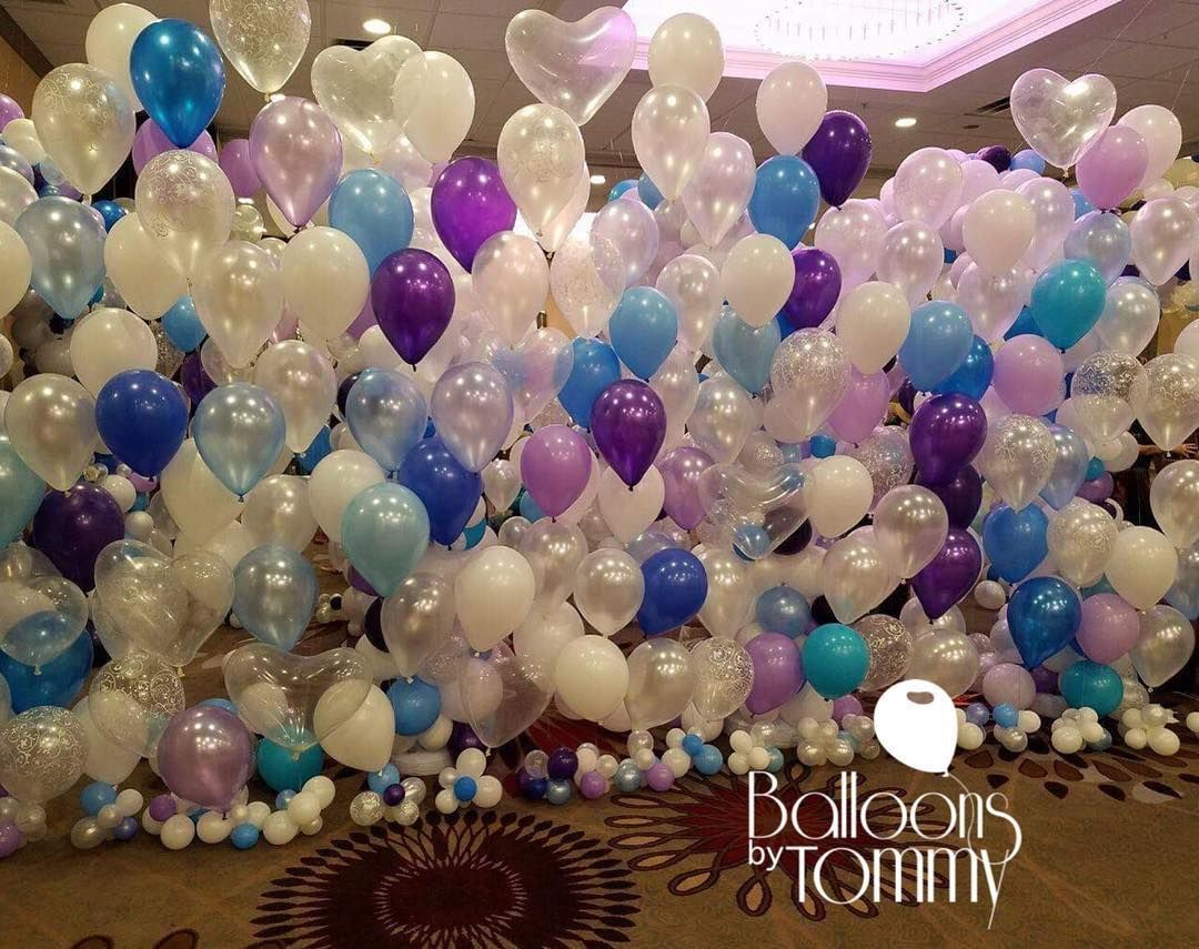 Wedding stage decoration with balloons  Balloon walls are great for photo ops stage backgrounds and
