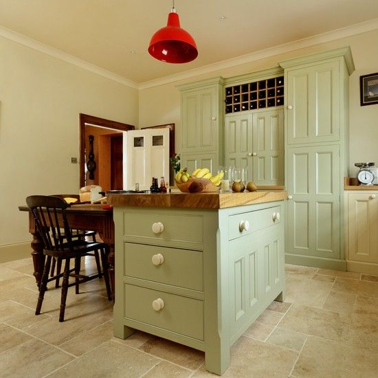 Country kitchen with green island unit Tiles with sage cupboards