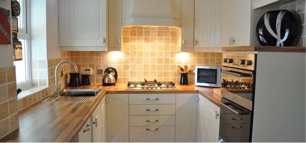 White Kitchen With Wooden Worktops falstone ivory kitchen with oak block laminate worktops | kitchen
