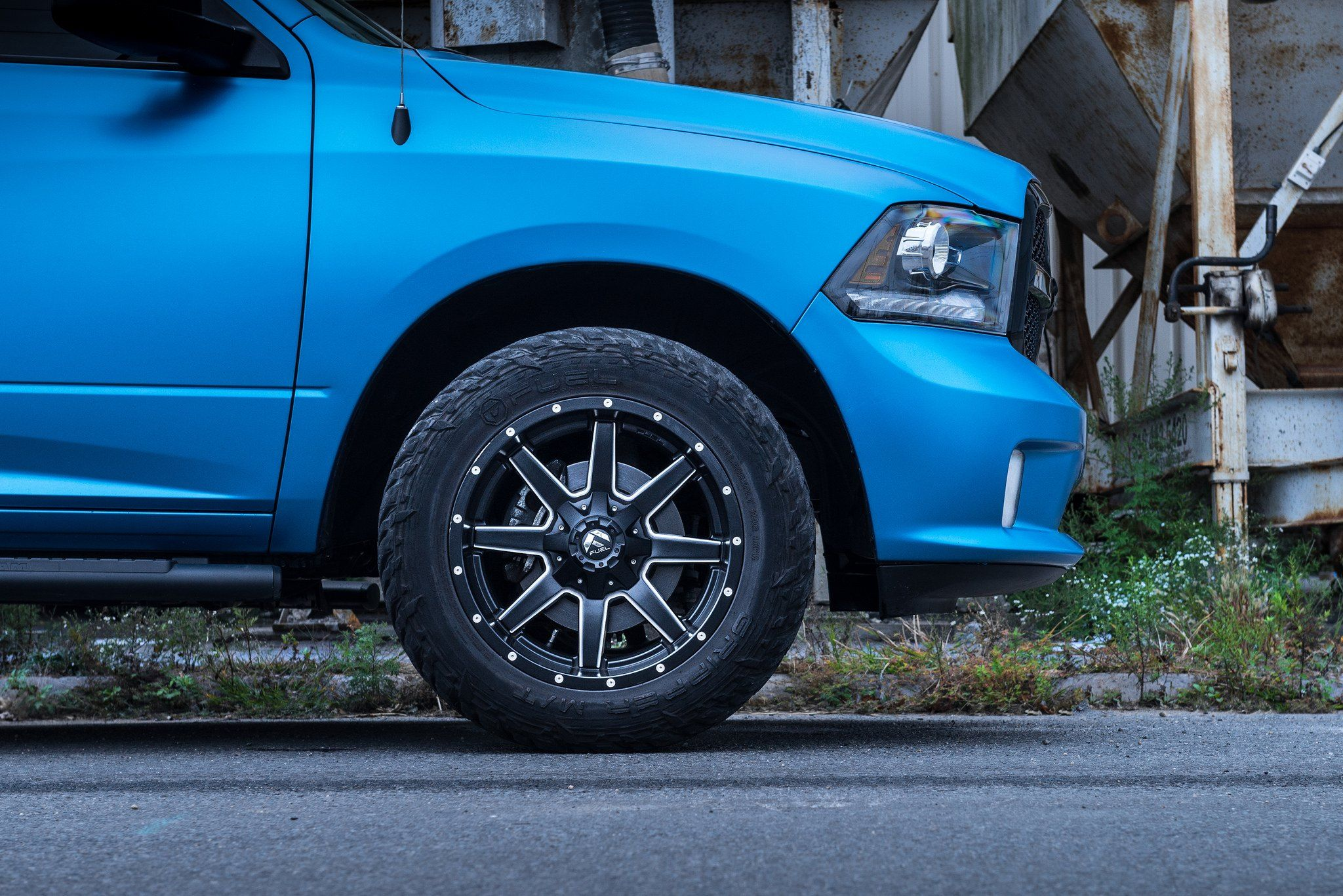 blue chrome wrapped ram on fuel maverick wheels and 33 inch tires