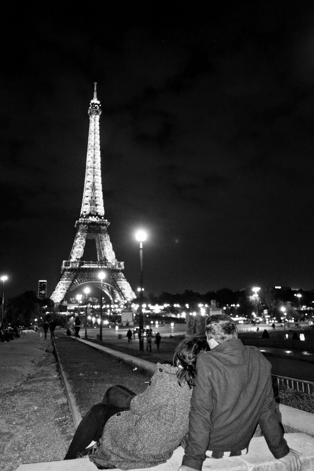 Romantic night in front of the Eiffel Tower