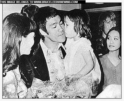 Shannon Lee showing her father Bruce Lee that she really knows that being in his arms she couldn't be any place safer in the world...with a kiss.