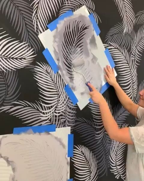 DIY painted and stenciled dark accent wall ideas on a budget using easy to use tropical palm fronds wall stencils from