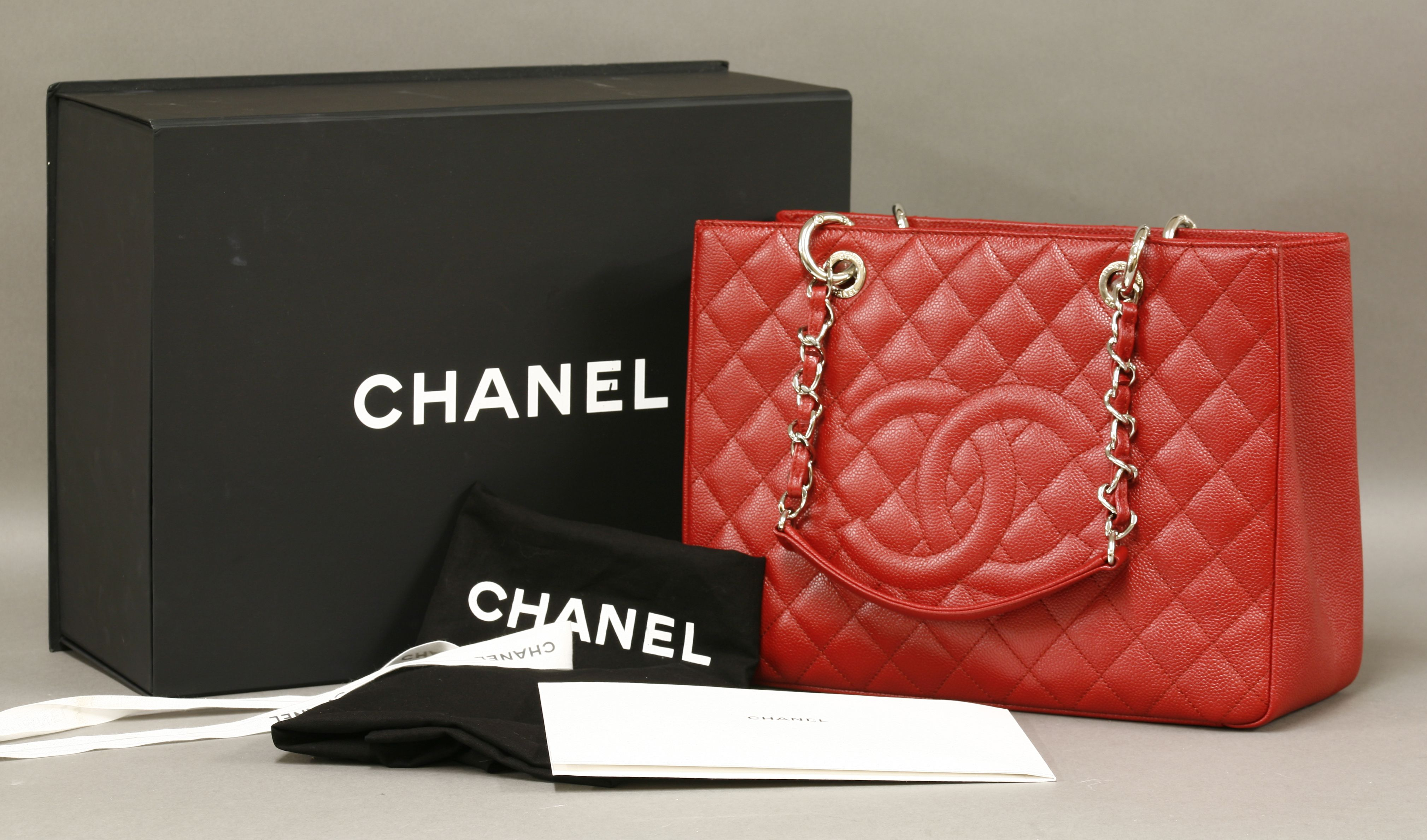 09545e0537e A Chanel red caviar leather quilted grand Shopper tote bag Hammer £1700