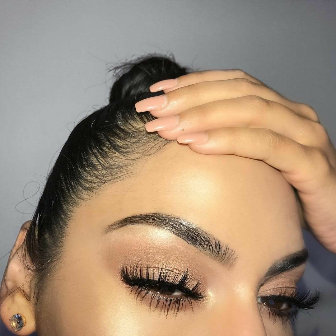 Long beautiful natural lashes. Get this look, plus many