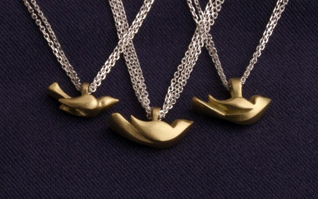 saw jade moran's bird charm a while back; still in love with the look of multiple  and different metal chains with then.  (somerville-local jeweler!)