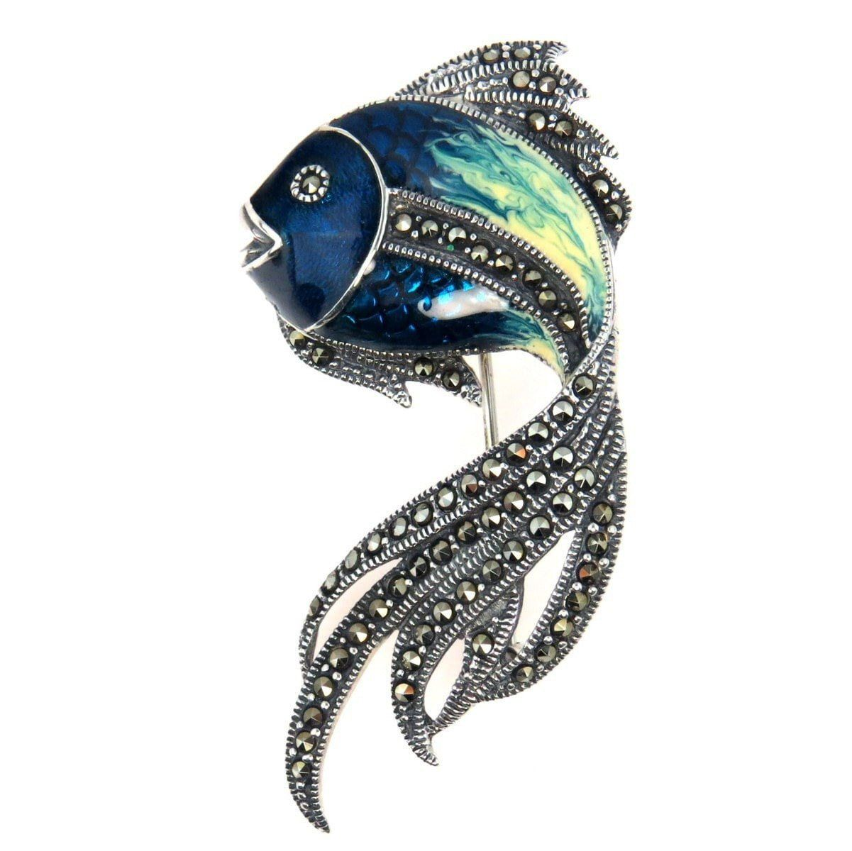 """Sterling Enamel Marcasite Koi Fish Brooch, Vintage, 1930s to 1980s   This happy fish brooch is so cute! Made in Sterling Silver, hand applied vitreous enamel in shades of blue on the body. The eyes, fins, and gills are set with marcasite pave. This cutie measures 2 1/4"""" by 1 1/8"""" and weighs approximately 10 gram. Pre-owned and in excellent condition with no damage. Marked 925, AM for the maker and the number 1407. Estimated to date from the 1980's.  ✨ Only one at…"""