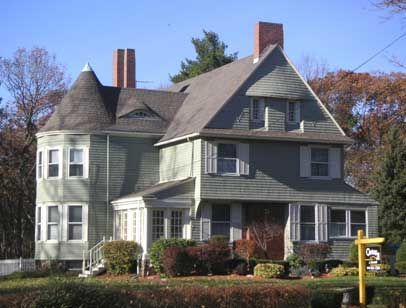 This Shingle Style House Features A Tower Blended Into The