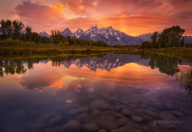 The Grand Teton Mountains Seen Over A Very Calm Section Of