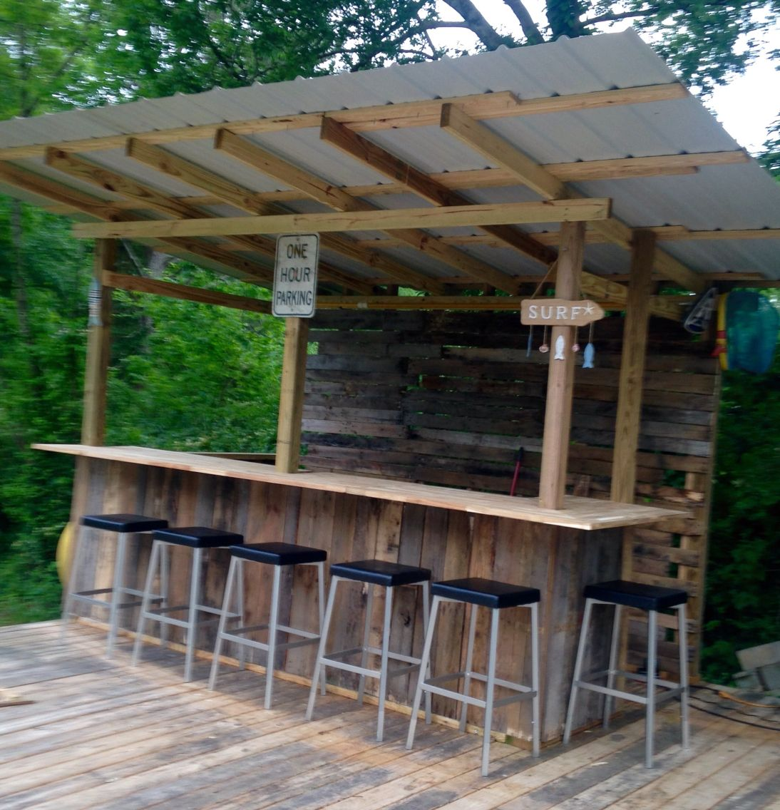 Our little tiki bar from pallet wood and salvaged metal for Wood outdoor bar ideas
