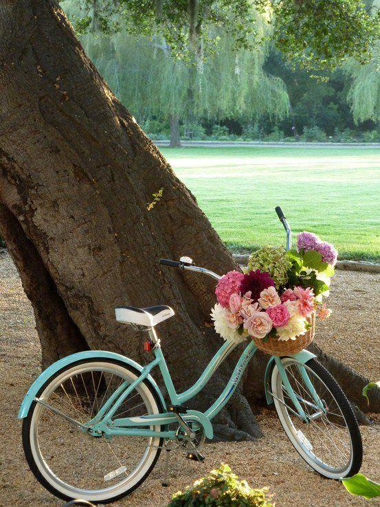 Girls vintage style bike with basket full of flowers light blue