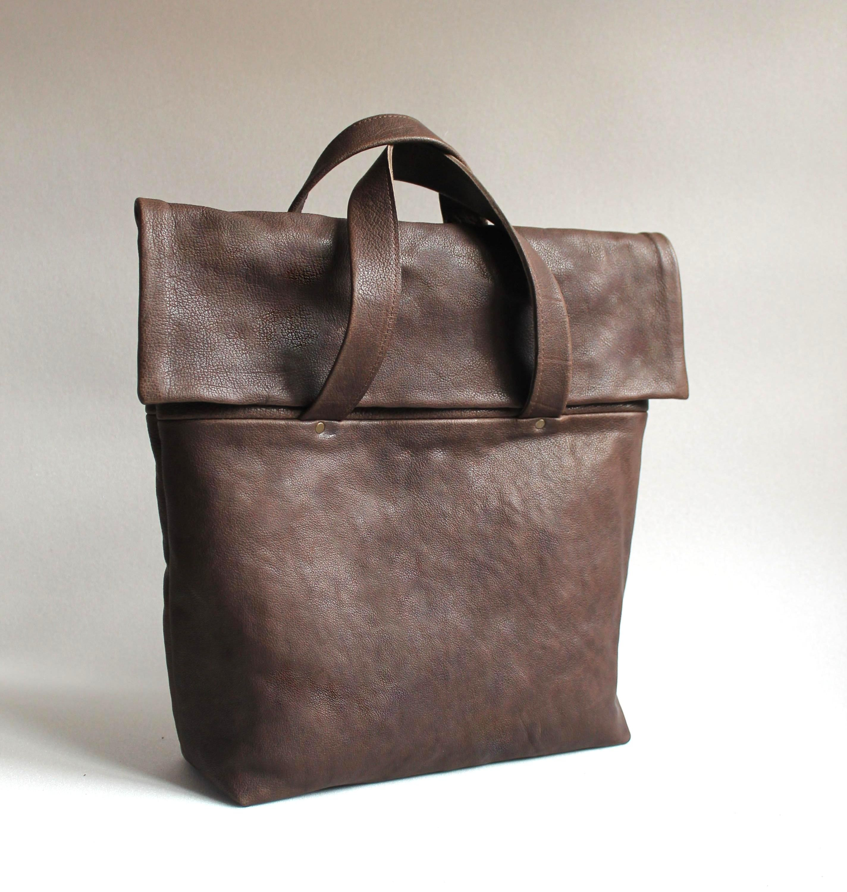 brown leather briefcase by nastya klerovski