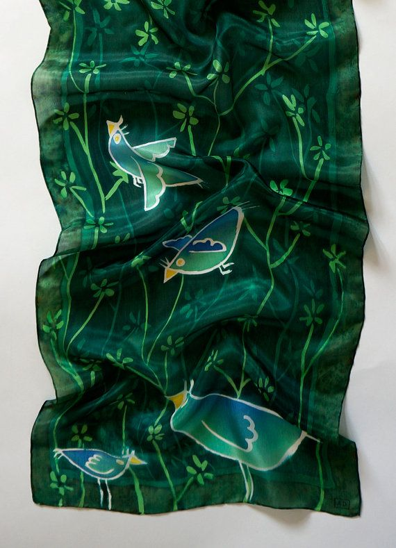 Birdies Hang Out, a batik silk scarf hand painted with birds on a dark emerald green floral pattern base, hand made in London