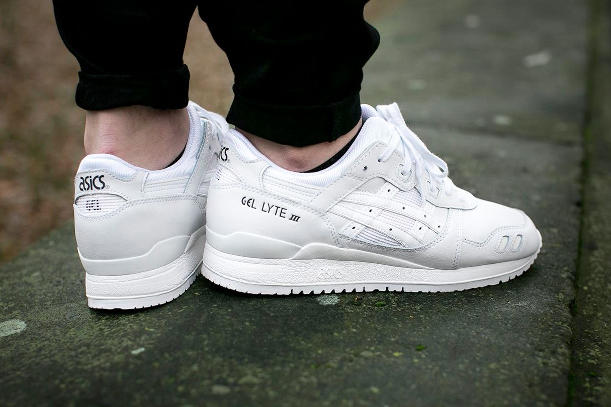 all white asics on feet