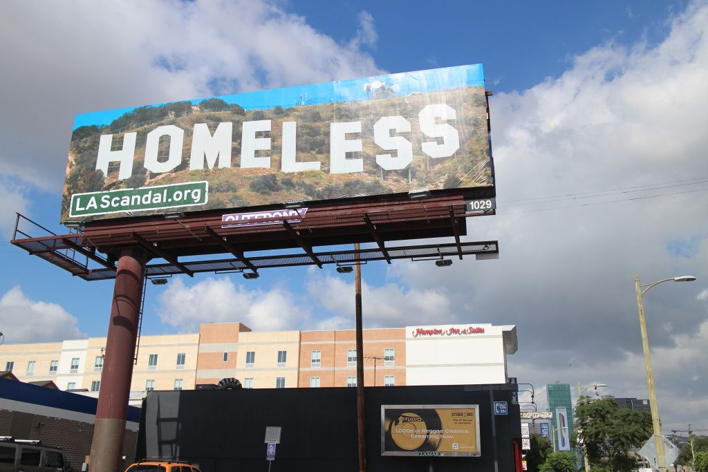 Turning An Iconic L A Image On Its Head More Than A Dozen Billboards Around The City Feature The Hollywood Sign Replac Billboard Hollywood Sign Urban Poverty