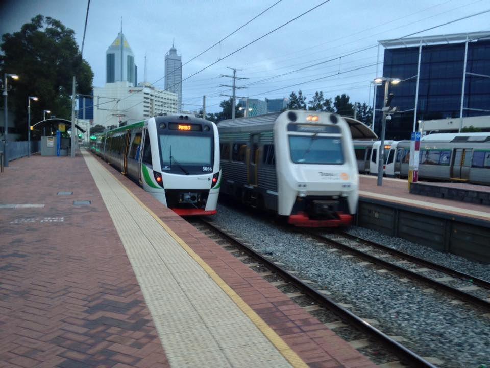 The transWA Australind DMU is seen passing a suburban