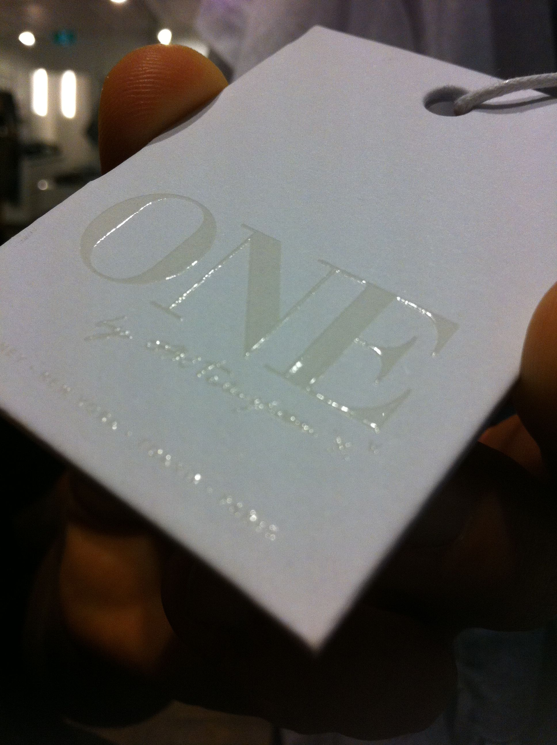 Swing Tag Research Raised lettering Matte card with shiny