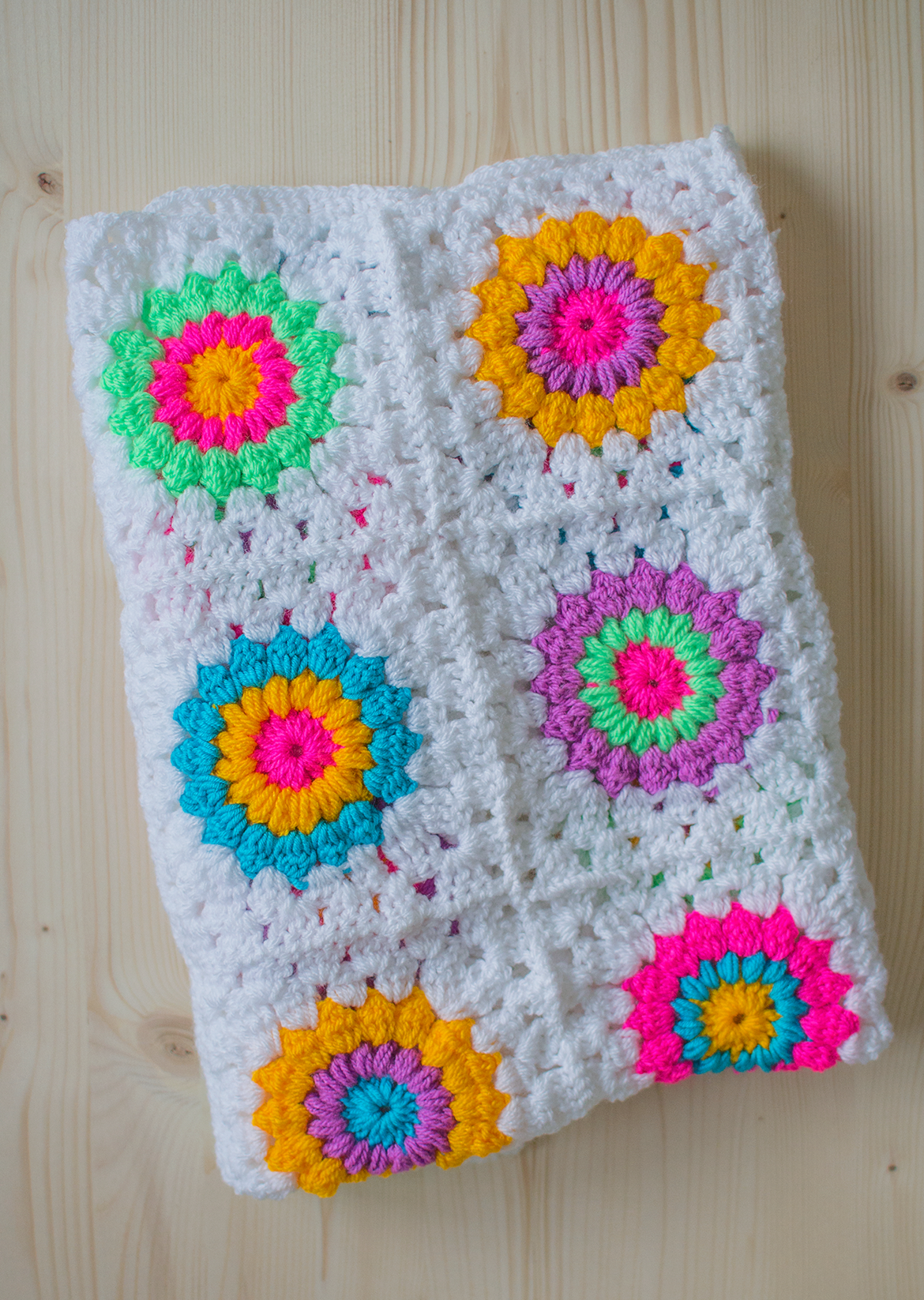 My Latest Crochet Projects - bright and colourful sunburst granny square crochet blanket