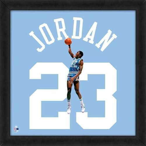 Featured is a Michael Jordan framed North Carolina jersey photo ...