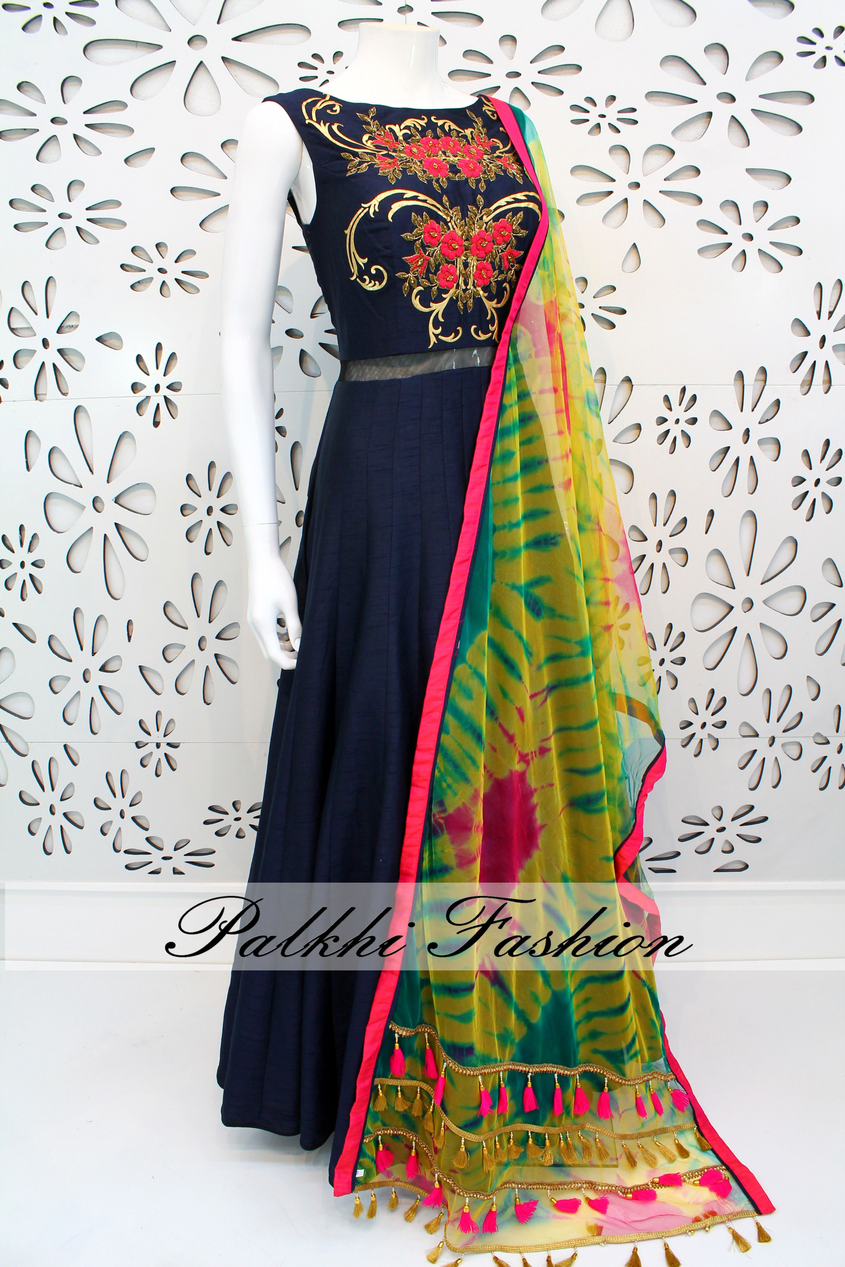 2911df2790 Elegant raw silk gown is embellished with antique gold zardozi and resham  accents. This outfit comes with contrasting soft net dupatta with tie die  accents