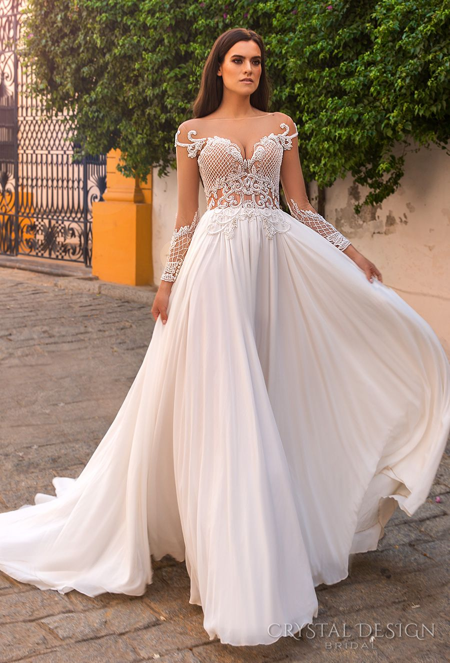 Crystal Design 2017 Bridal Long Sleeves Illusion Bateau Neckline Heavily Embroidered Bodice Lace Flowy Skirt A Line Wedding Dress Open Back Chapel