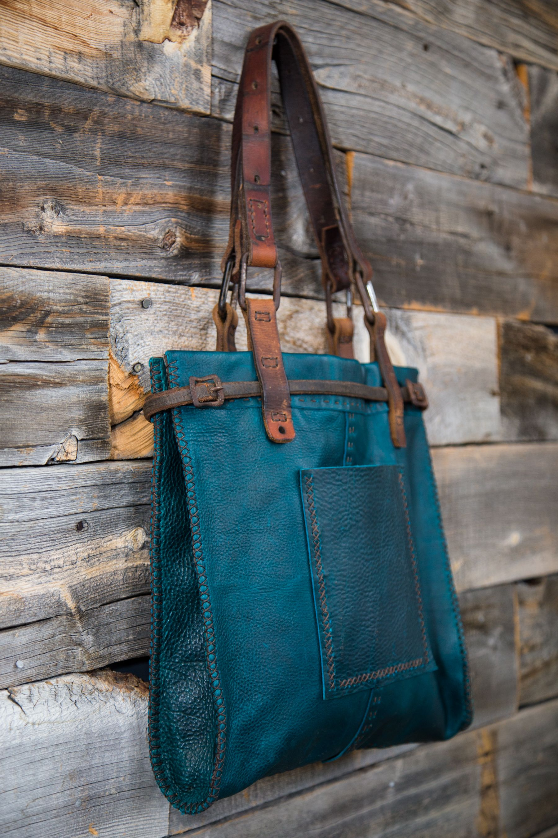 CIBADO leather bags Entirely hand sewn teal buffalo leather tote  incorporating vintage horse tack to become handles and decorative detail. e42fe0654b52d