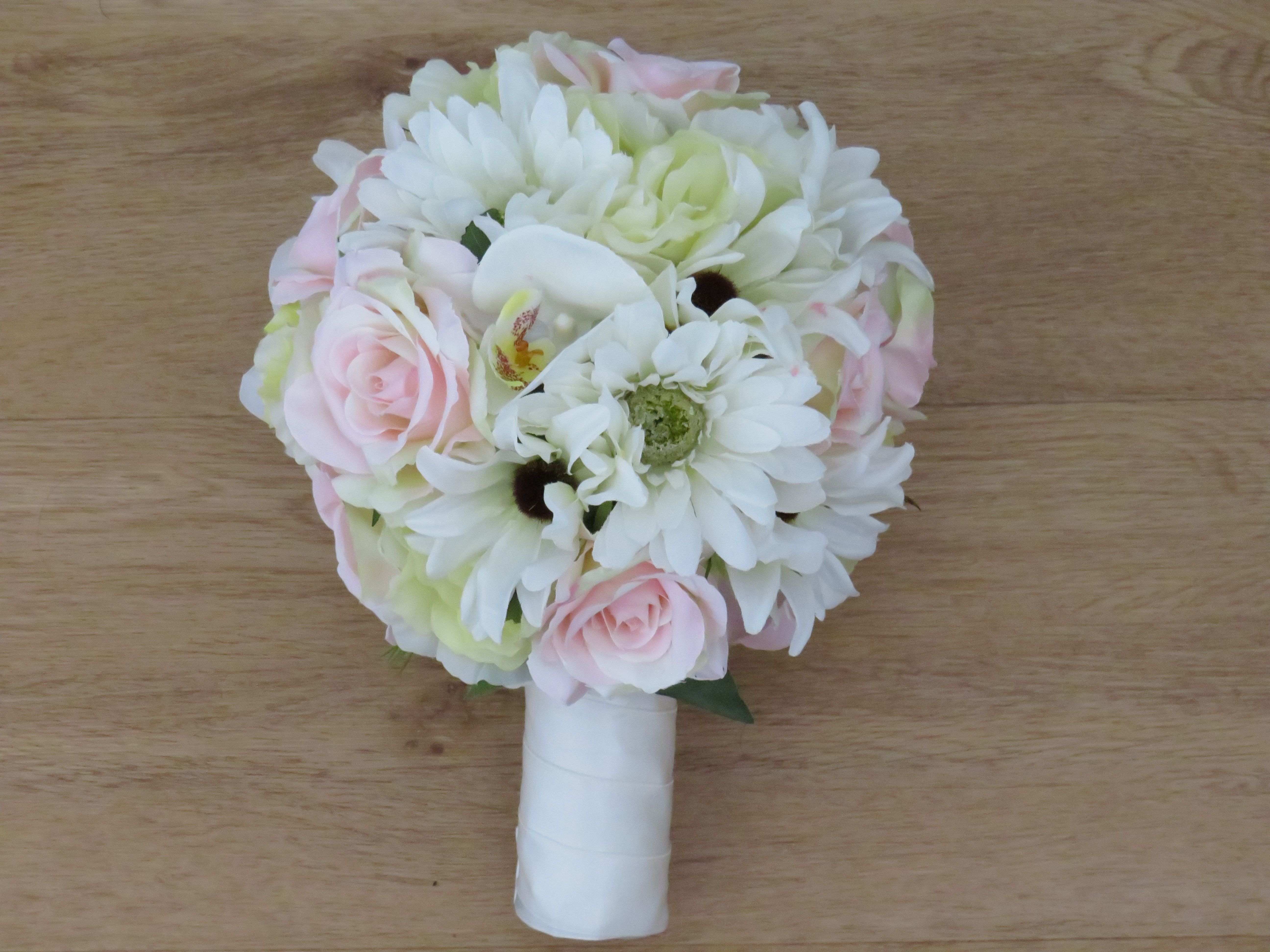 A Country Gardenboho Style Wedding Bouquet With A White Satin Wrap