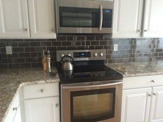 brown subway tile backsplash kitchen
