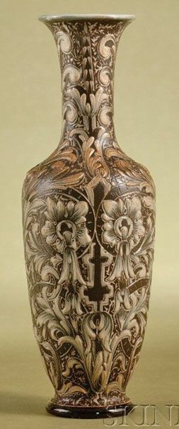 A Doulton Lambeth Salt-Glazed Stoneware Vase, by Edith Rogers, overall design of raised white acanthus leaves on a brown ground, England, circa 1882