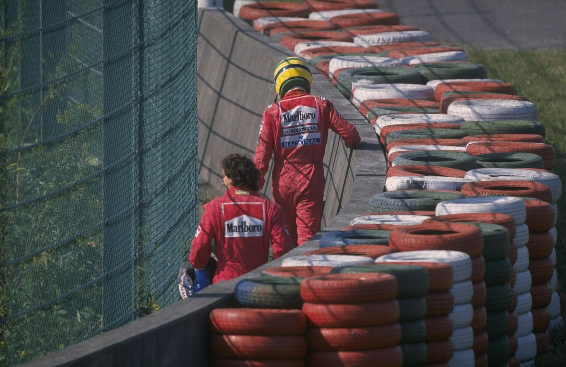 Senna and Prost walk back to the pits in Japan Senna