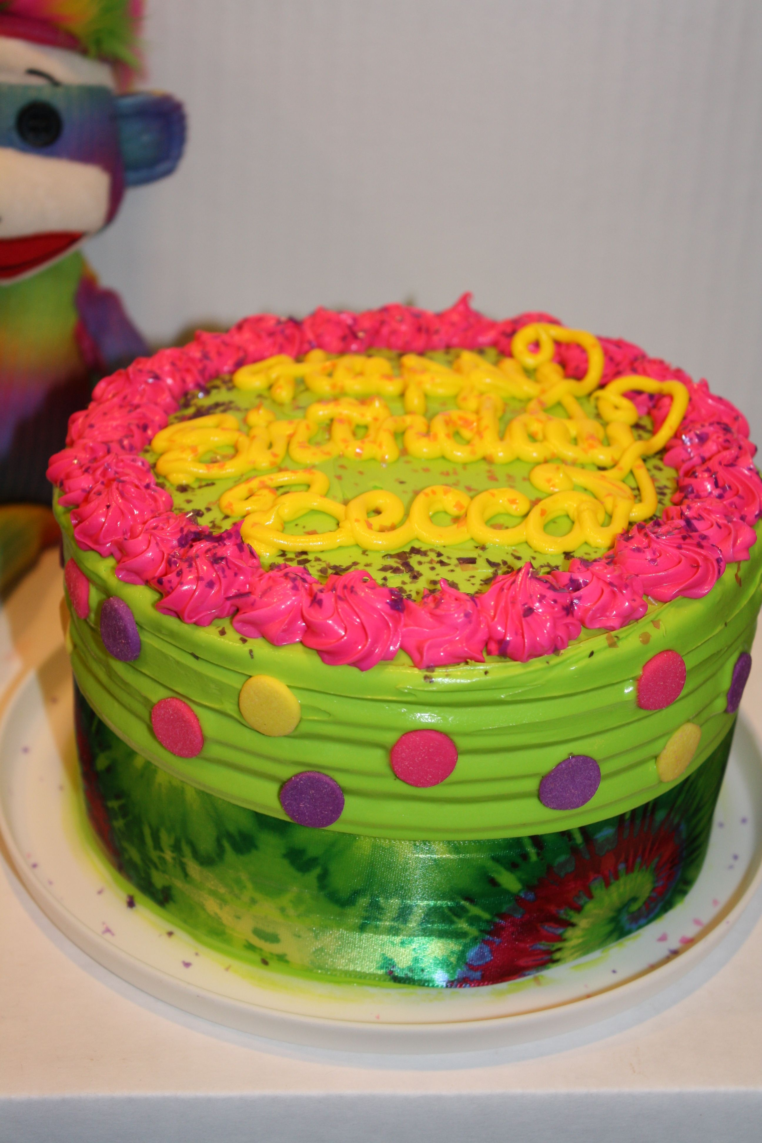 Neon cake for a preteen girlinspired by a sock monkeyby