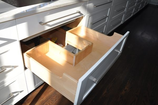 Under Sink Drawer With Cutout To Make Room For Plumbing.