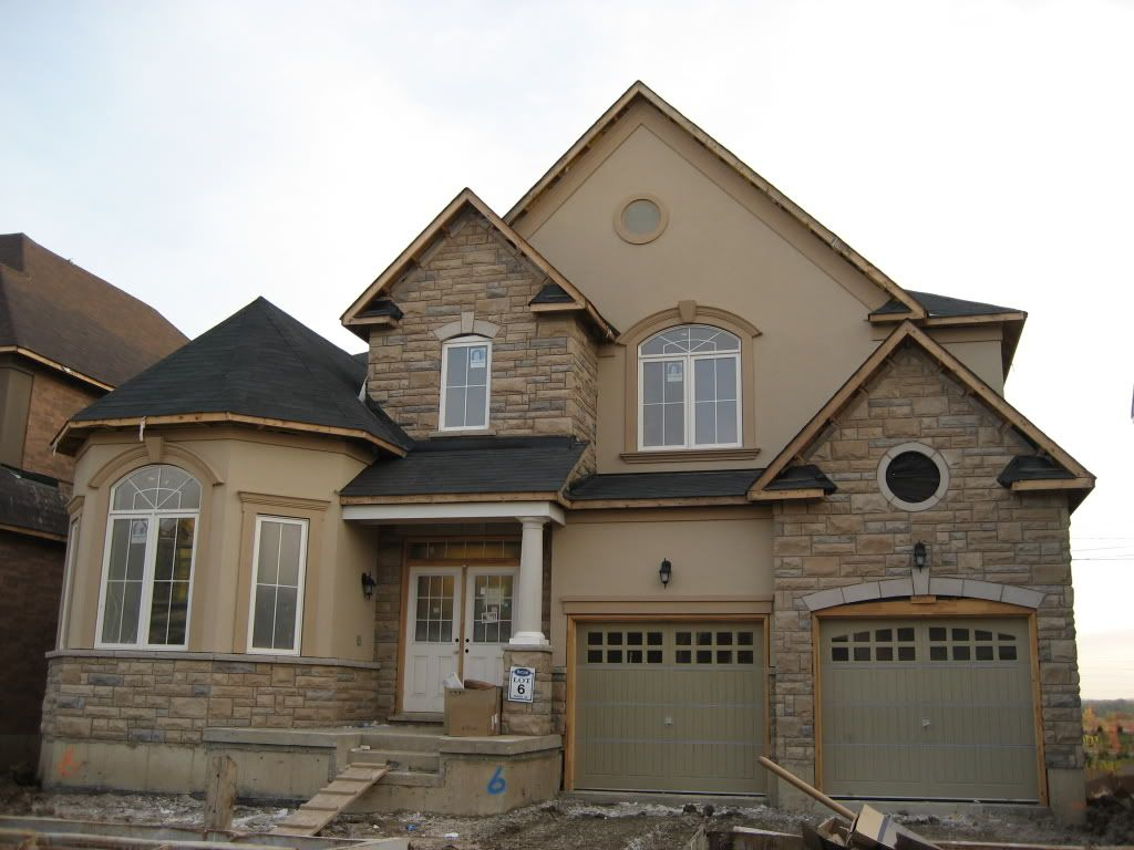 Exterior paint schemes with stucco and stone com for Stucco house paint colors