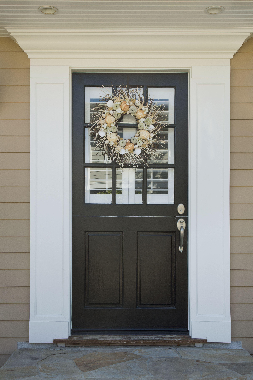 Autumn Wreath On A Dark Wood Front Door. The Front Door Has Glass Panels  With