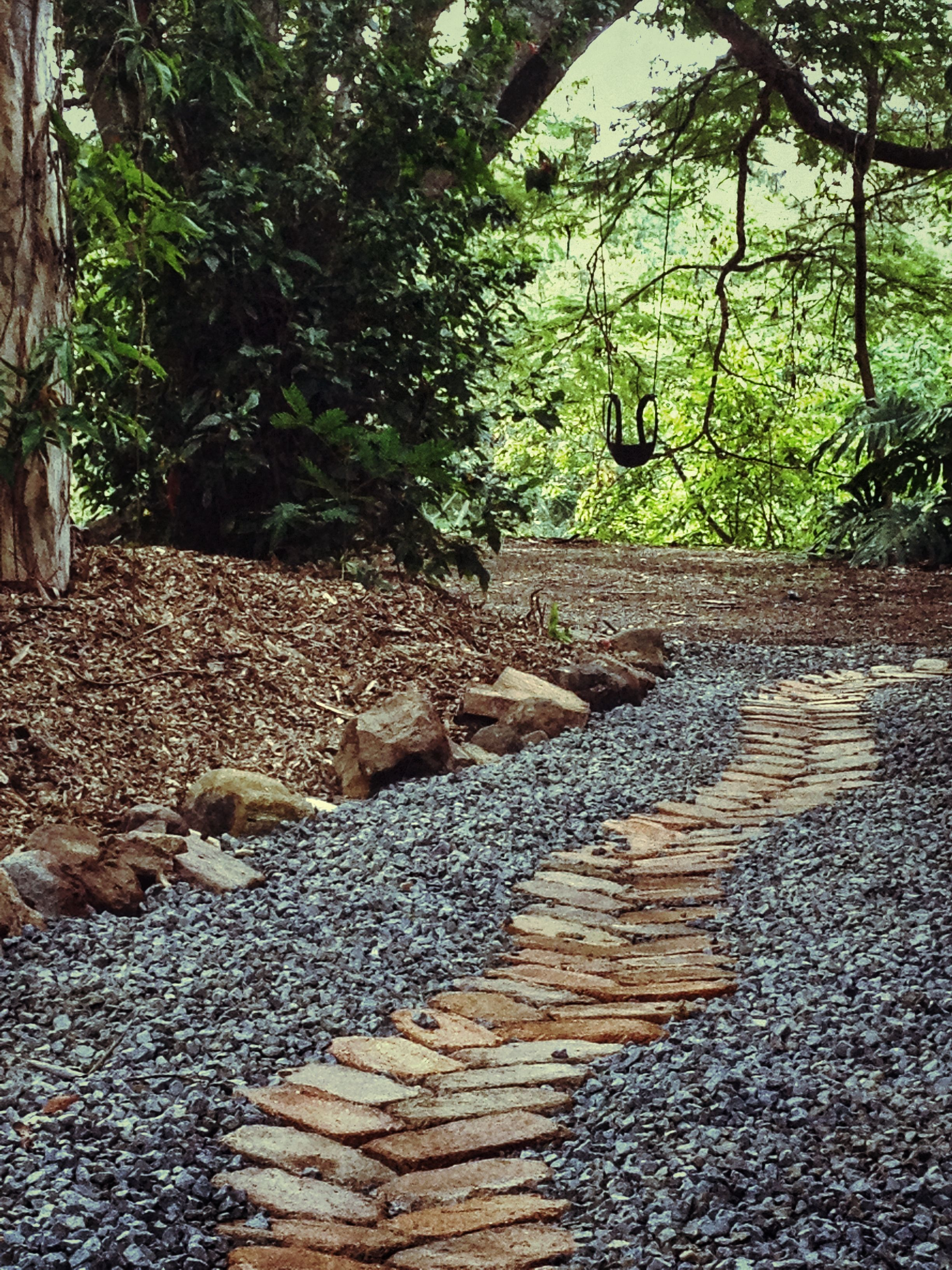 Recycled bricks and 20mm of blue metal gravel were used to for Cement garden paths